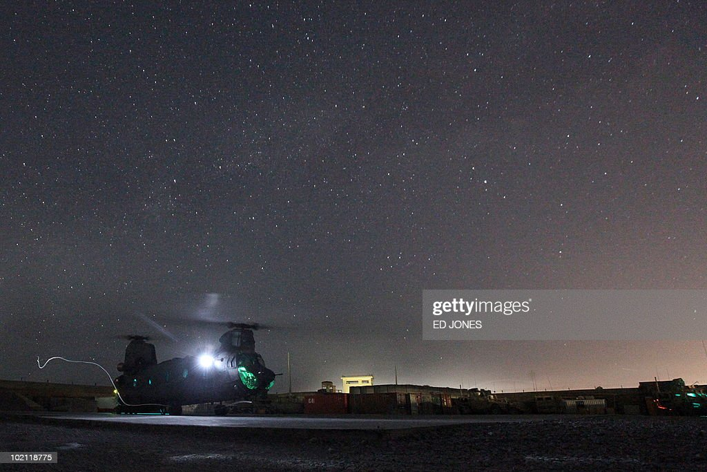Army helicopter makes a brief stopover during night time at Camp Nathan Smith in Kandahar City on June 15, 2010. A district chief, his son and a bodyguard were killed by a car bomb in southern Afghanistan's Taliban heartland of Kandahar city on June 15, police said.