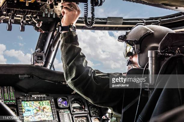 army helicopter pilot riding black  helicopter - piloting stock pictures, royalty-free photos & images