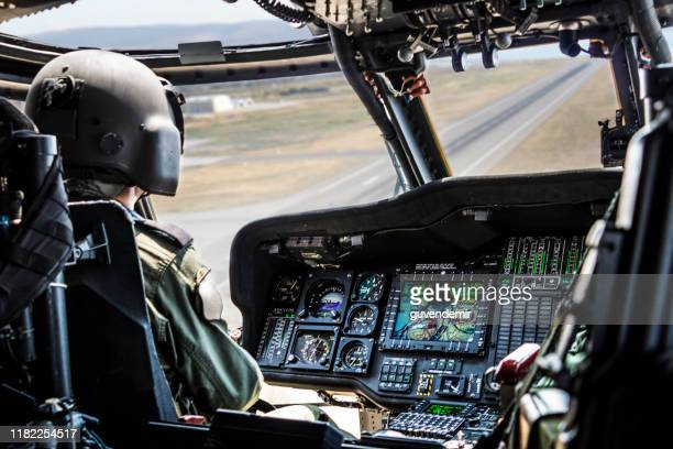 army helicopter pilot riding military helicopter - army stock pictures, royalty-free photos & images