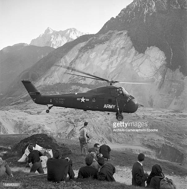 Army helicopter takes off full of evacuated refugees Longarone near the Vajont Dam in the Piave Valley Italy early October 1963 On October 9 a...