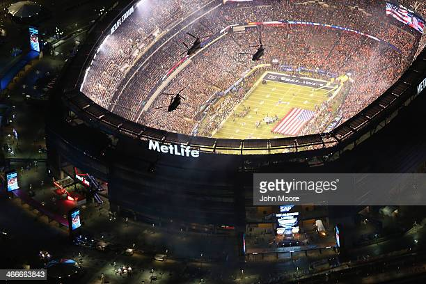 Army helicopters from the 101st Combat Aviation Brigade fly over Metlife Stadium ahead of Super Bowl XLVIII between the Seattle Seahawks and the...