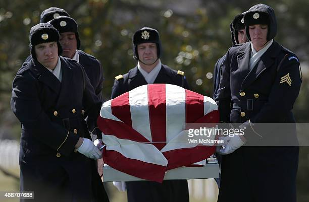 S Army honor guard carries a casket with the remains of eight airmen who were listed as missing in action during a burial service at Arlington...