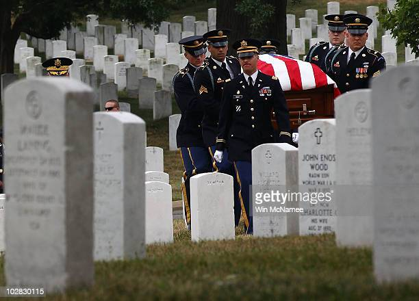 S Army honor guard carries the casket of World War I casualty Private First Class Thomas D Costello during his burial service at Arlington National...