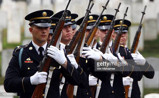 S Army honor guard firing party prepares their salute for World War I casualty Private First Class Thomas D Costello at his burial service at...