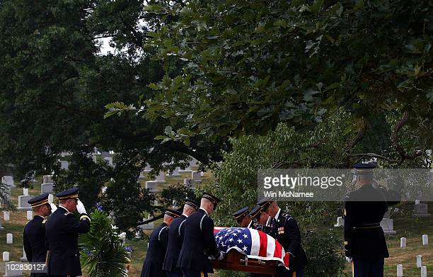 S Army honor guard places the casket of World War I casualty Private First Class Thomas D Costello at his gravesite during his burial service at...