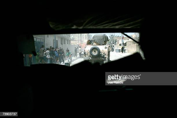 S Army humvee from the BCO 2/325 AIR 82nd Airborne Division drives through the streets during a patrol April 17 2007 in Baghdad IraqThe soldiers are...