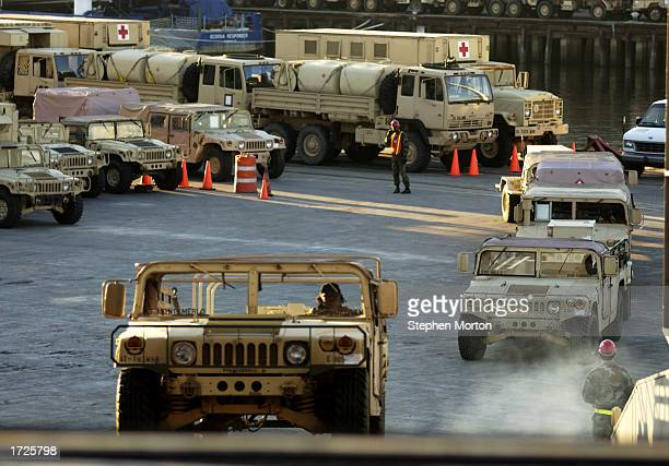 S Army Humvee is driven aboard the USNS Mendonca January 14 2003 at the Port of Savannah Georgia The Mendonca was being loaded with military hardware...