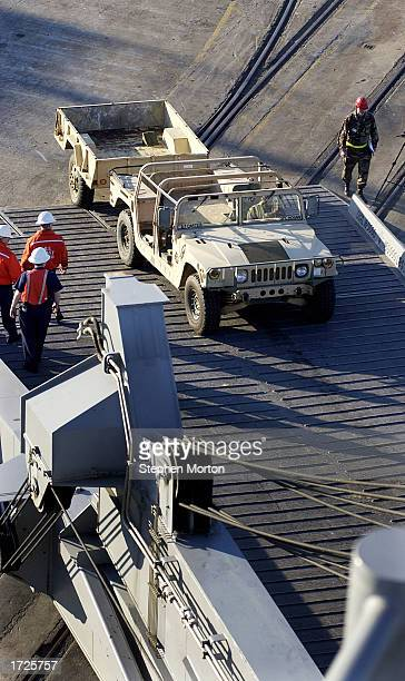 S Army Humvee is loaded from a dock January 14 2003 at the Port of Savannah Georgia The vehicle was being loaded aboard the USNS Mendonca which will...