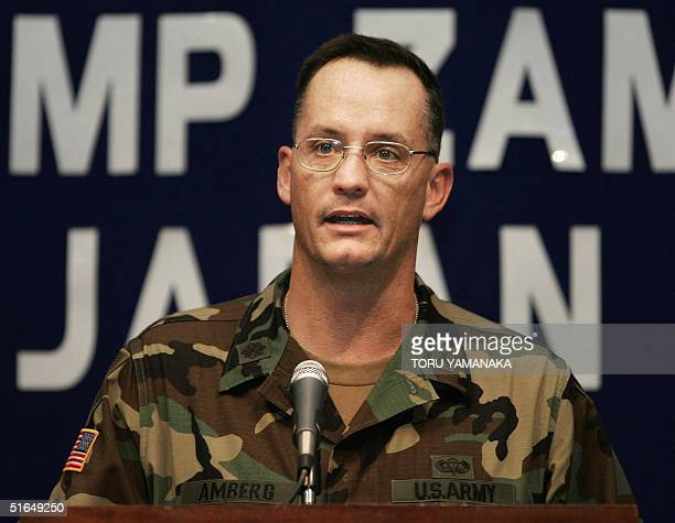 Army in Japan Public Affairs Director LTC John W. Amberg speaks to journalists in Camp Zama, suburban Tokyo, 03 November 2004 after former US soldier...