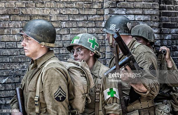 wwii us army infantry combat platoon waiting in line - military doctor stock photos and pictures