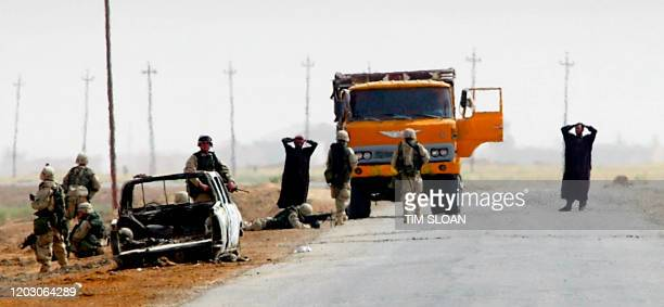 Army Infantry men stop and search vehicles and their drivers on Tallil Road, which leads north out of al-Nasiriyah, where the US Marines have been...