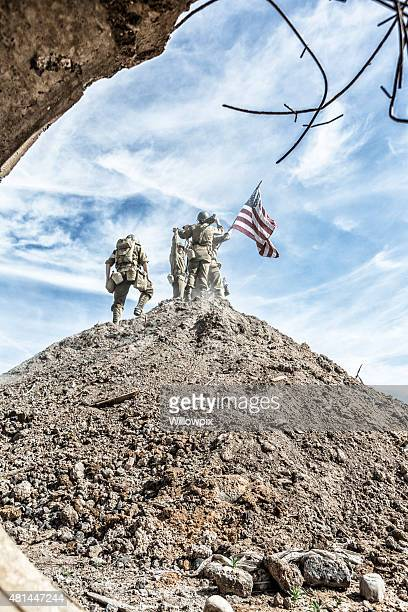 WWII US Army Infantry Squad Climbing Hill With American Flag