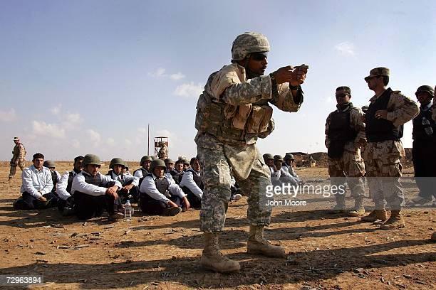 Army interpreter Danny Alawi trains Iraqi police cadets at a firing range January 10, 2007 in Anbar province, Ramadi, Iraq. U.S. President George W....