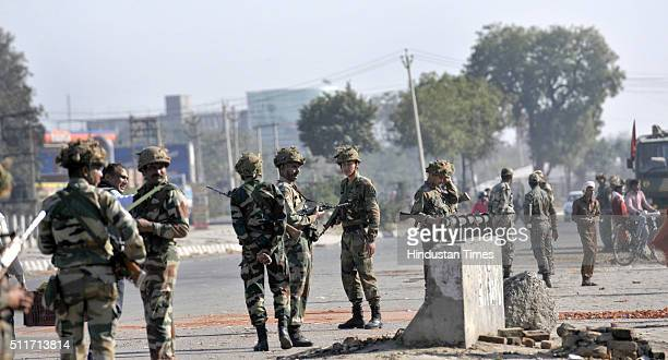 Army jawans deployed at village Siwah after Jat agitation turned violent on February 22 2016 in Panipat India Jats are agitating for quotas in jobs...
