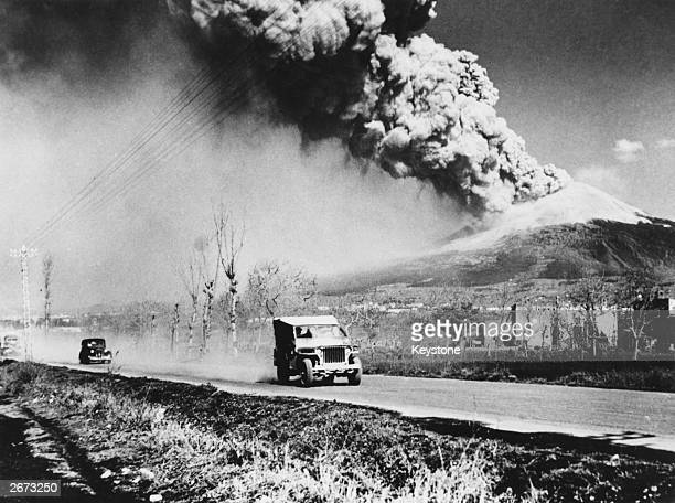 Army jeep speeds along a road near Mount Vesuvius during the volcano's worst eruption in more than 70 years The Americans used a fleet of vehicles to...
