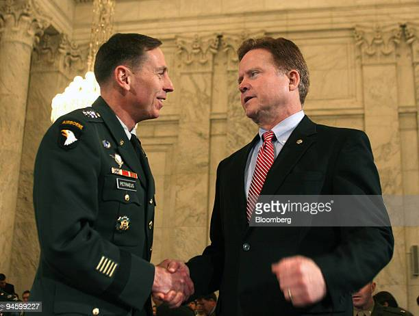 Army Lieutenant General David Petraeus left is greeted by Senator Jim Webb of Virginia before the start of Petraeus' confirmation hearing to be the...