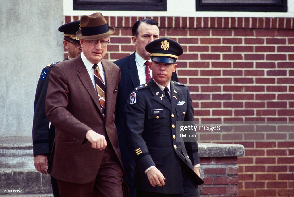 US Army Lieutenant William Calley leaves military court with civilian attorney George Latimer and military attorney Major Kenneth Raby at the conclusion of several days of pre-trial hearings. Calley is on trial for his role in the My Lai massacre during the Vietnam War.