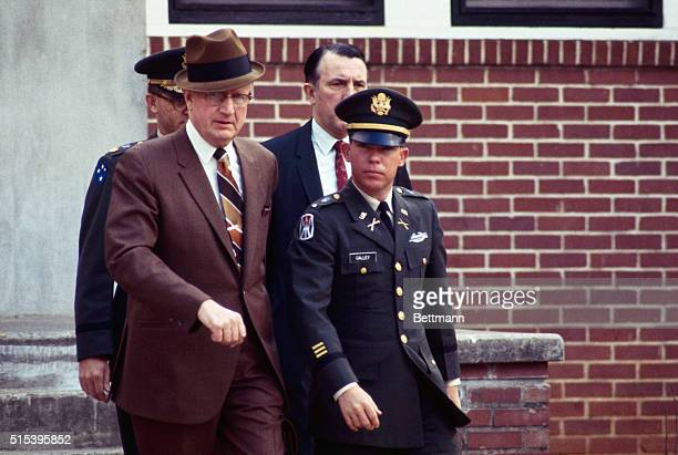 US Army Lieutenant William Calley leaves military court with civilian attorney George Latimer and military attorney Major Kenneth Raby at the...