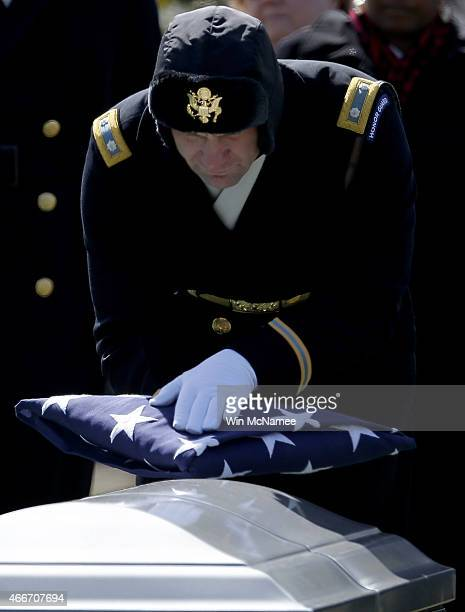 S Army Lt Col David S Taylor touches an American flag to a casket with the remains of eight airmen who were listed as missing in action during a...