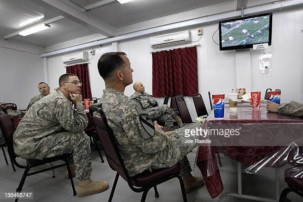 S Army Lt Col Robert Wright from Lampasas Texas the Commander of the 282 Field Artillery 3rd Brigade 1st Cavalry Division and other soldiers watch...
