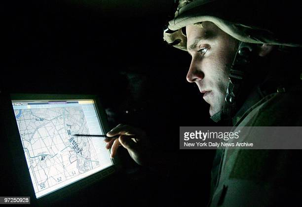 Army Lt Matt Caldwell of Staten Island NY checks his Humvees position during a night patrol in Baqubah Iraq with his platoon of the 3rd Brigade 1st...