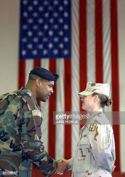 Army LT Megan Pascoe , who arrived on February 01 from Iraq, shakes hands with Colonel George Washington during a welcoming ceremony at a US army...