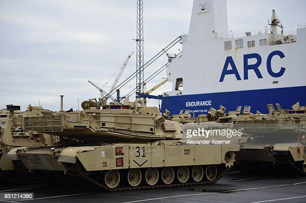 Army M1 Abrams and other military vehicles stand in line prior being loaded onto trains after being unloaded from ships two days before on January 8...
