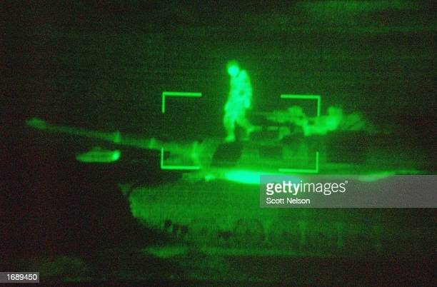 S Army M1/A1 Abrams tank crews with 'charlie' company 464 Armored Battalion are seen through the thermal imaging sights of a tank as they participate...