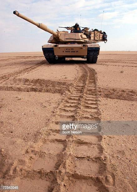 S Army M1/A1 Abrams tank from Charlie company of the 464 Armored Battalion changes position during task force manuevers December 18 2002 near the...