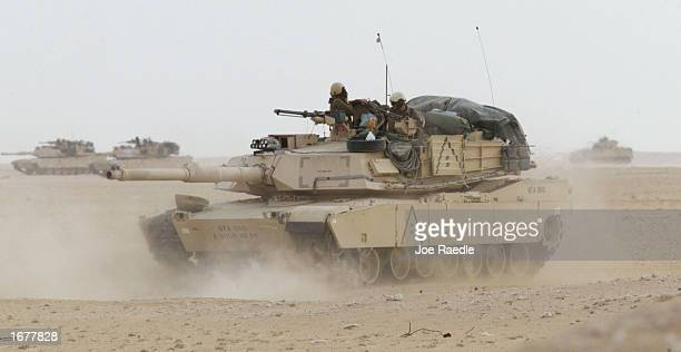 S Army M1A1 Abrams tank plows through the desert sands December 8 2002 near the Iraqi border in Kuwait The tank which is part of the 464 Armored...