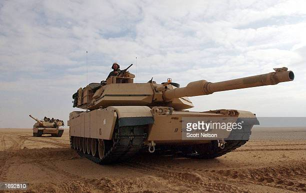 S Army M1/A1 Abrams tanks from Charlie company of the 464 Armored Battalion are deployed during task force manuevers December 18 2002 near the Iraqi...