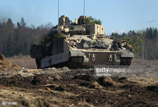 Army M2A3 Bradley fighting vehicle of Chaos Company, 1-68 Armor Battalion of the 3rd Brigade Combat Team, 4th Infantry Division, attacks an enemy...