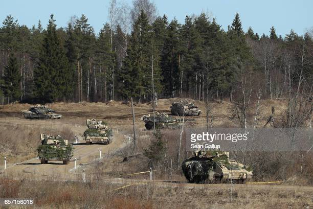 Army M2A3 Bradley fighting vehicles and M1 Abrams tanks of Chaos Company 168 Armor Battalion of the 3rd Brigade Combat Team 4th Infantry Division...