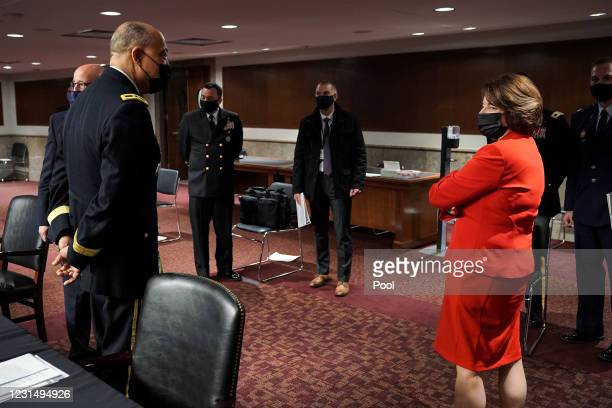 Army Maj. Gen. William Walker, Commanding General of the District of Columbia National Guard speaks to Sen. Amy Klobuchar after a Senate Homeland...