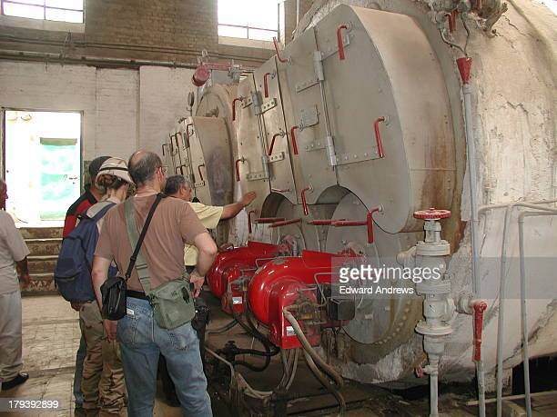 Army Major and Army civilian volunteers of Forward Engineer Support TeamAdvanced FESTA examine condition of boilers for the Baghdad Train Station as...