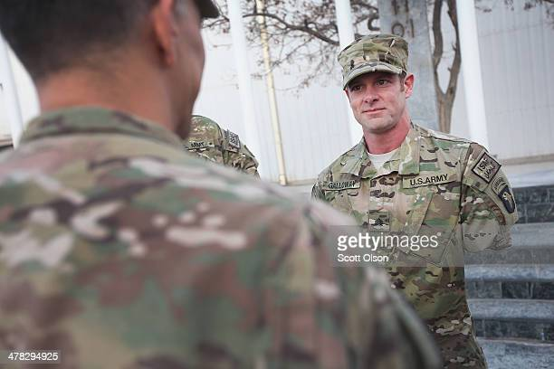 S Army Major General Stephen Townsend commanding general of Combined Joint Task Force 10 and Regional Command East commander greets SGT Noah Galloway...