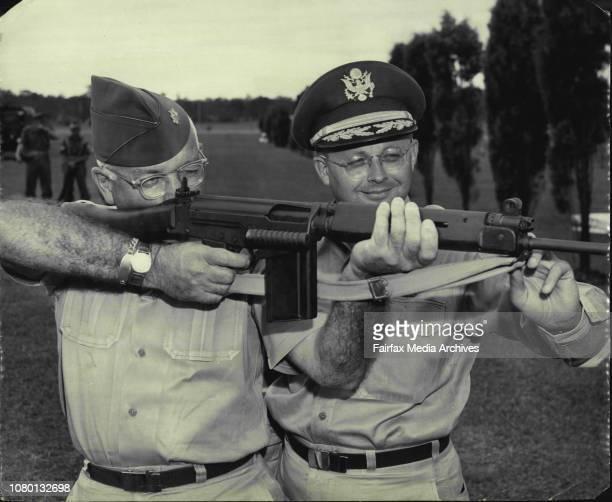 Army Major J.J. Sinnott, sights up Australia's new F.N. Rifle. Major R.M. Ripley of Headquarters, U.S. Army Pacific, Fort Shafter, Hawaii looks...