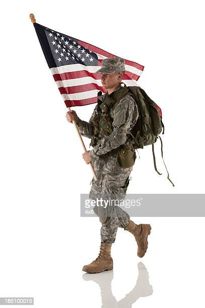 army man carrying an american flag - army soldier stock pictures, royalty-free photos & images