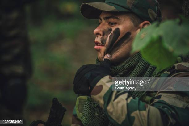 army man preparing for war - camouflage clothing stock pictures, royalty-free photos & images