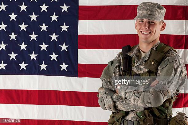 Army man standing in front of American flag