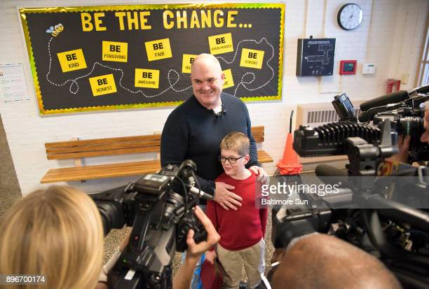 Army Master Sgt Thomas Pardue and his son Ebin Pardue are interviewed by a brace of cameras after Pardue surprised his son him by returning early...