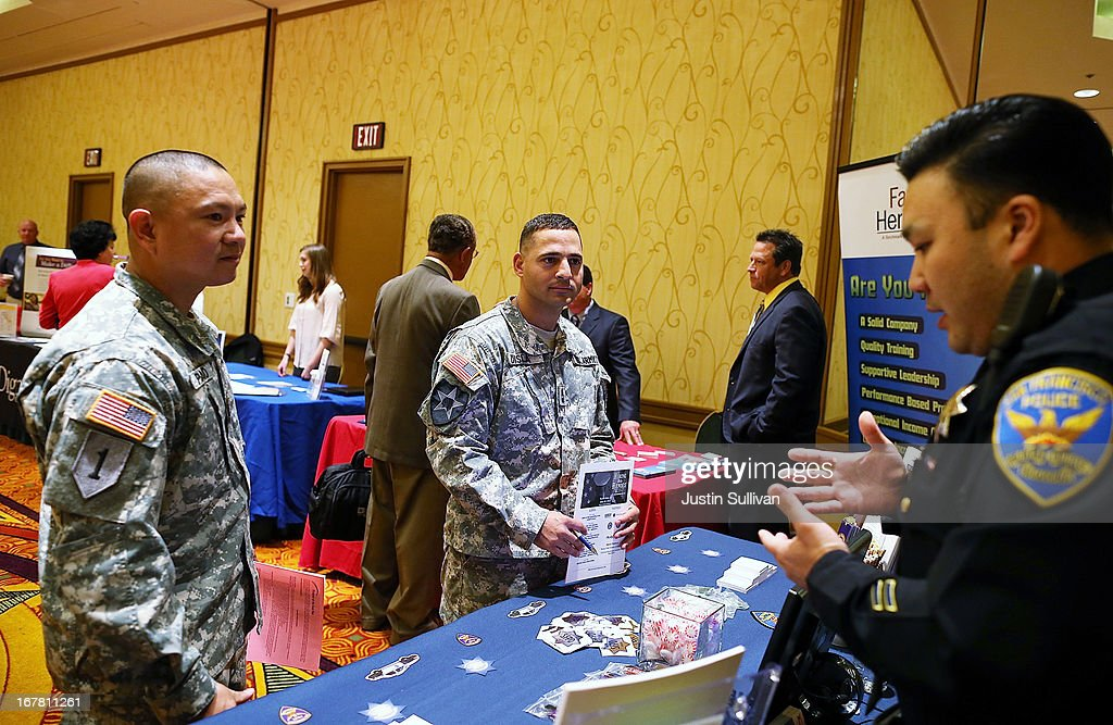 U.S. Army Master Sgt. Yeffiry Disla (C) and U.S. Army Sgt. First Class Alvin Prado (L) meet with a recruiter from the San Francisco police department during the 'Hiring Our Heroes' job fair on April 30, 2013 in Walnut Creek, California. Seventy-five active duty members of the military and veterans registered to attend the 'Hiring Our Heroes' job fair hosted by the U.S. Department of Commerce. Hundreds of 'Hiring Our Heroes' events are being held across the country in 2013 in the hopes of having a half million military veterans employed by the end of 2014.