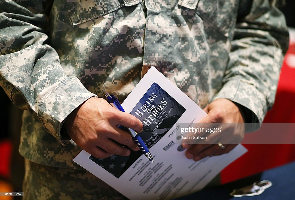 U.S. Army Master Sgt. Yeffiry Disla holds a job fair information sheet as he meets with a recruiter from the San Francisco police department during the 'Hiring Our Heroes' job fair on April 30, 2013 in Walnut Creek, California. Seventy-five active duty members of the military and veterans registered to attend the 'Hiring Our Heroes' job fair hosted by the U.S. Department of Commerce. Hundreds of 'Hiring Our Heroes' events are being held across the country in 2013 in the hopes of having a half million military veterans employed by the end of 2014.