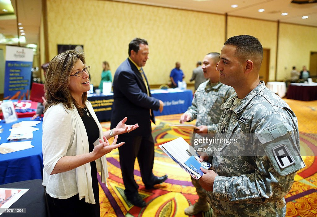 U.S. Army Master Sgt. Yeffiry Disla (R) meets with a recruiter during the 'Hiring Our Heroes' job fair on April 30, 2013 in Walnut Creek, California. Seventy-five active duty members of the military and veterans registered to attend the 'Hiring Our Heroes' job fair hosted by the U.S. Department of Commerce. Hundreds of 'Hiring Our Heroes' events are being held across the country in 2013 in the hopes of having a half million military veterans employed by the end of 2014.
