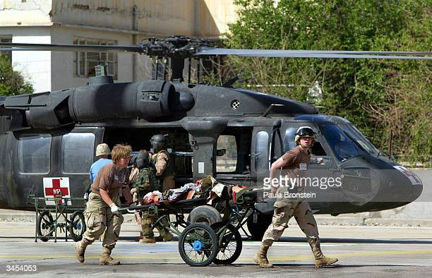 S Army Medical personnel with the 2nd Medical Brigade carry a medevaced patient from the Abu Ghraib prison to the 31st Combat Support hospital April...