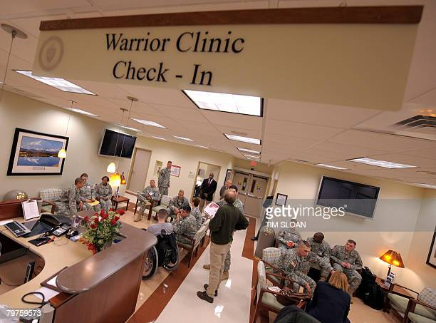 US Army medical staff and patients sit in the lobby area of the new Warrior Clinic on Feburary 14 2008 at the Walter Reed Army Medical Center in...