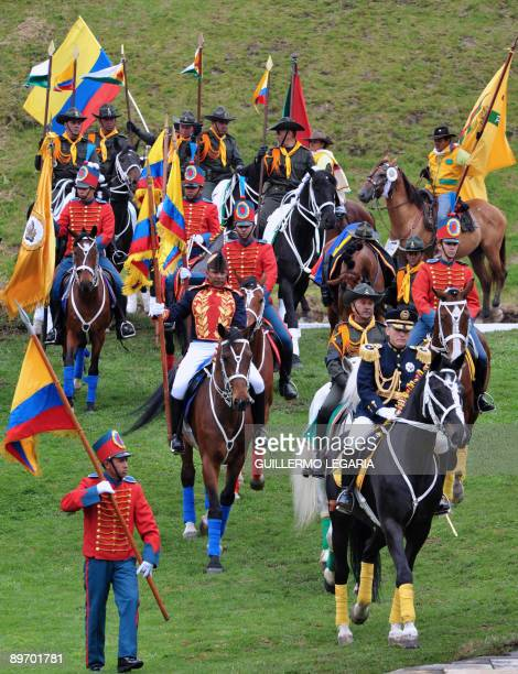 Army members and police officers dressed in traditional uniforms parade during the anniversary of the Colombian Independence near Tunja Colombia on...