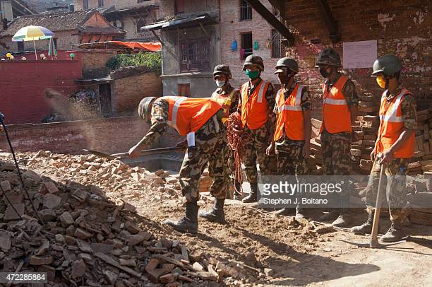Army members dig out a destroyed house in Bhaktapur. A major 7.9 earthquake hit Kathmandu mid-day on Saturday, April 25th, and was followed by...
