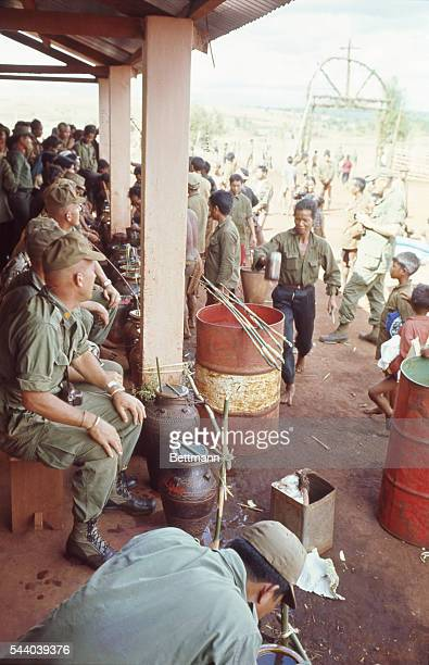US Army men as they celebrate Christmas with the Montagnards