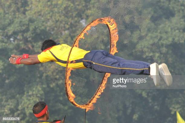 Army men display their skill by jumping through a firering during the Vijay Diwas a ceremony to celebrate the liberation of Bangladesh by the Indian...